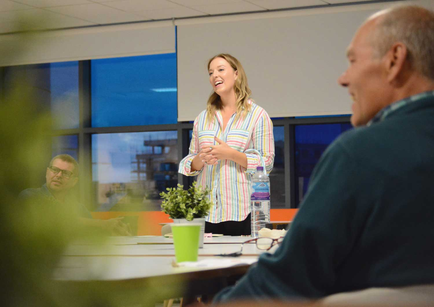 culture consultant Lizzie Benton stands up in front of people to deliver a company culture workshop.