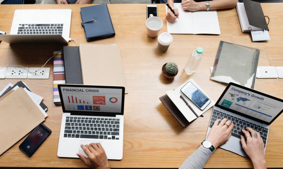 team measuring company culture around desk