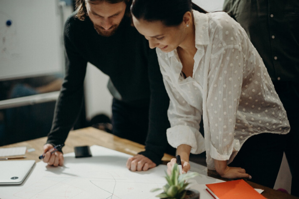 man and woman planning company culture