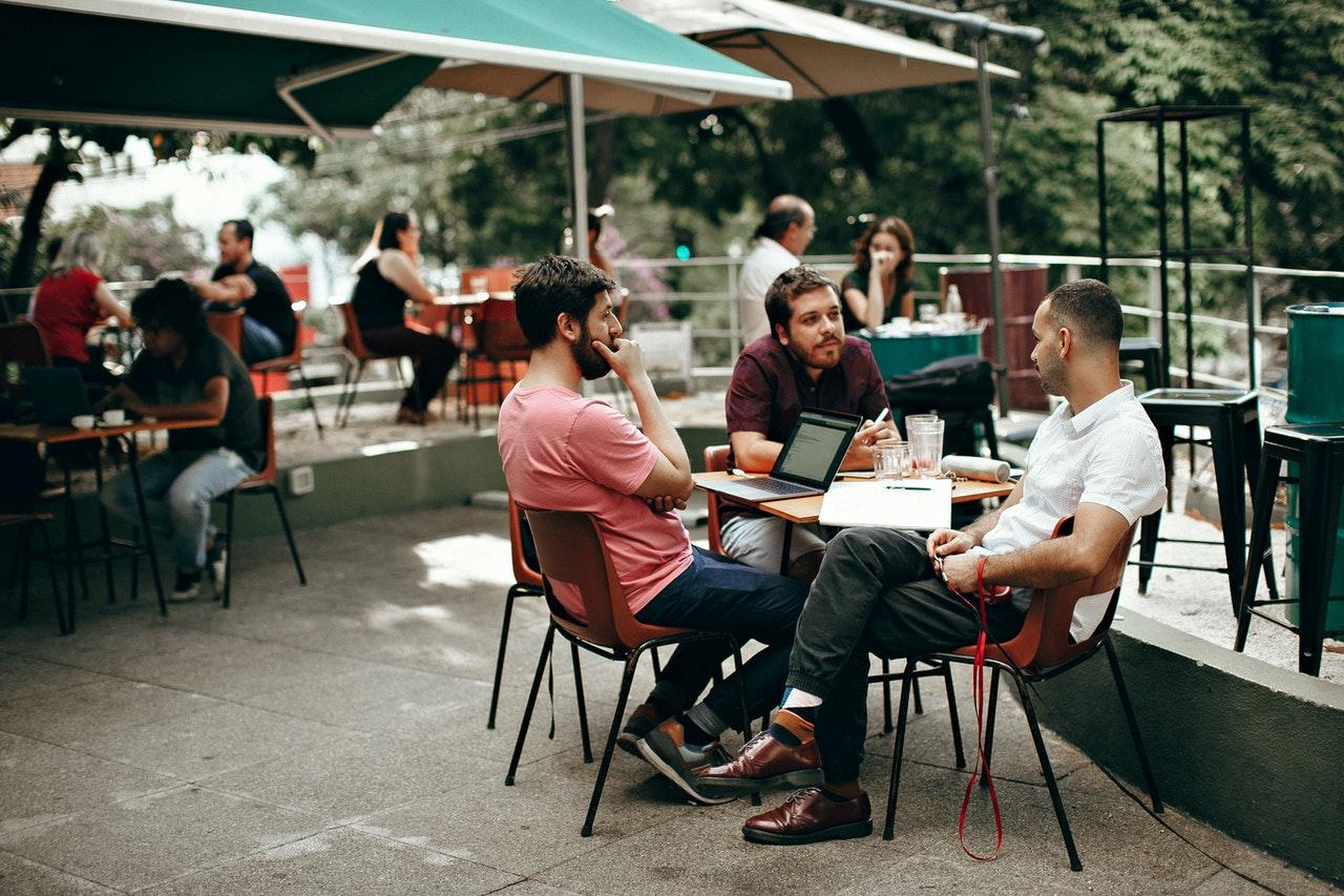 men drinking coffee at Starbucks