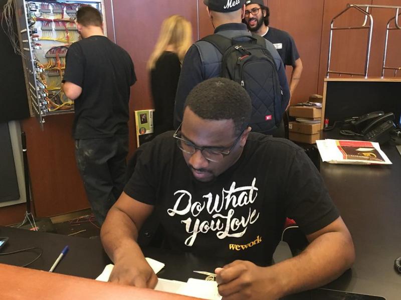 wework employee wearing a do what you love tshirt